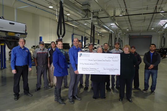 A ceremonial check is presented recently by Vescovo Toyota to benefit scholarships for Doña Ana County Community College students in the automotive technology program.