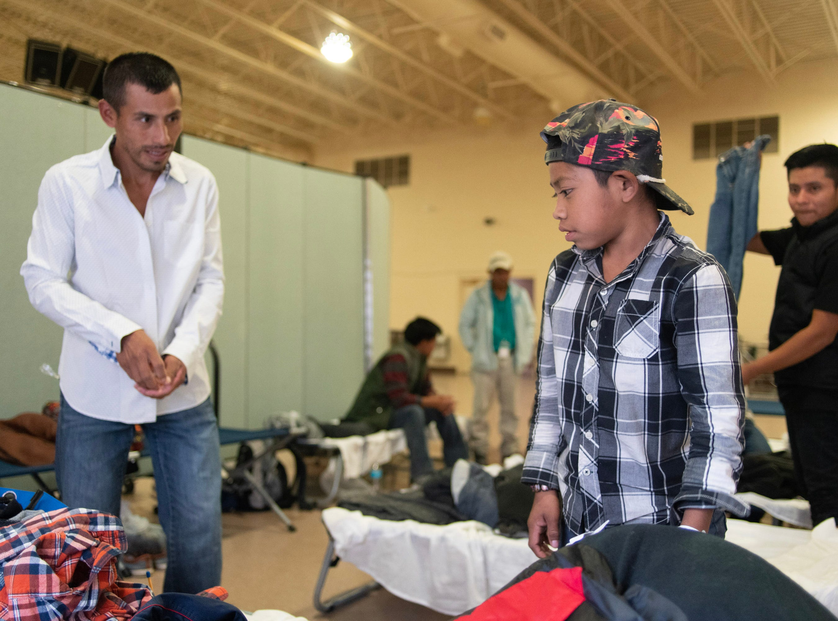 Vicente Yaxal and his son, Sergio, from Carchá, Alta Verapaz, Guatemala, at a migrant shelter in Doña Ana County.