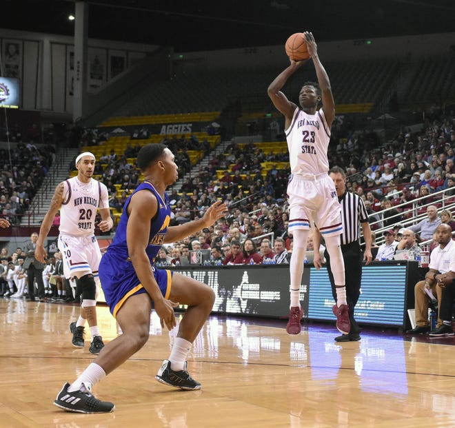 New Mexico State's Mohamed Thiam shoots a 3-point shot during the first half against Missouri Kansas City on Thursday at the Pan American Center.