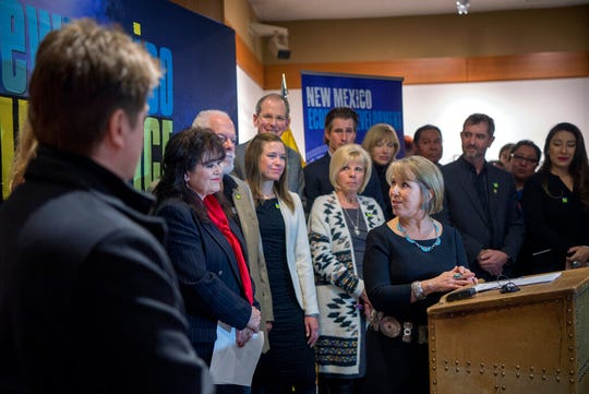 New Mexico Gov. Michelle Lujan Grisham, center, holds a news conference about film incentives with Sen. Nancy Rodriguez, D-Santa Fe, second from left,and others Friday Feb. 1, 2019, in Santa Fe, N.M. Incentives aimed at attracting more filmmakers to New Mexico would get a boost under legislation supported by Grisham as neighboring Texas and other states contemplate similar proposals to sweeten the draw for production companies.
