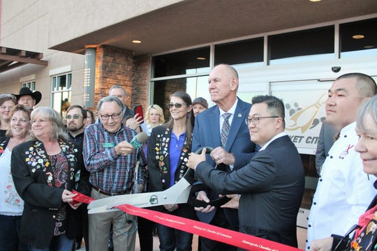 Alamogordo Mayor Richard Boss and Downtown Venture Corp. CEO Jay Chun, center, cut the ribbon marking the official opening of the Rocket City Fun Center. Downtown Venture Corp, is the management company behind the Rocket City Fun Center.