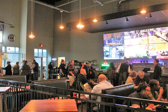 Rocket City Fun Center guests at the restaurant and sports bar inside the fun center Thursday evening.
