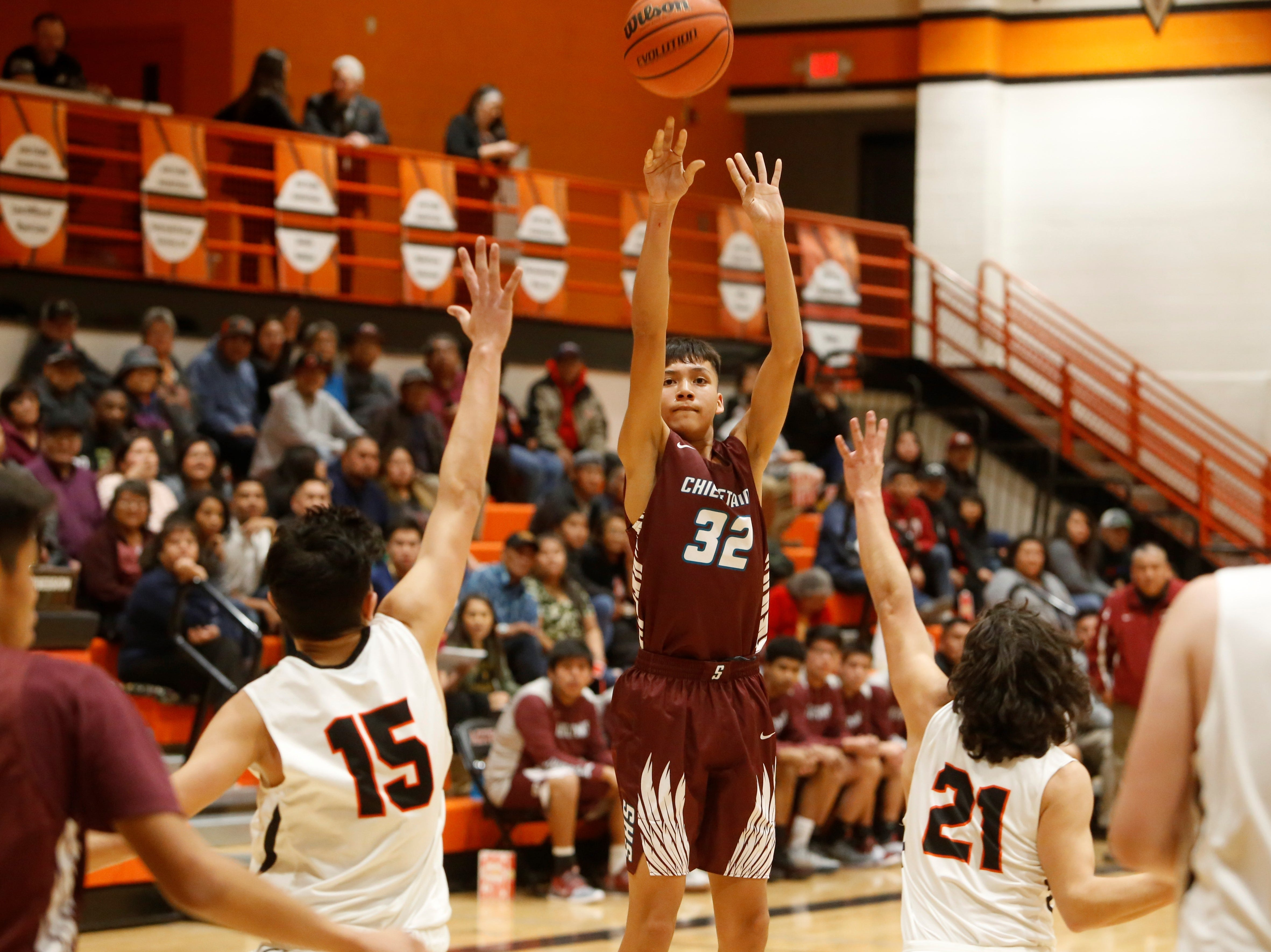 Shiprock's Shannon Dale fires a 3-pointer against Aztec during Thursday's District 1-4A game at Lillywhite Gym in Aztec.