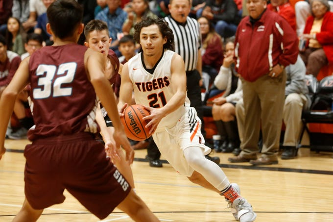 Aztec's Javier Valenzuela cuts left toward the basket against Shiprock during Thursday's District 1-4A game at Lillywhite Gym in Aztec.