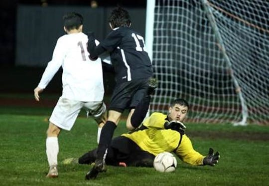 La Quinta's keeper saves a possible goal Thursday against Palm Springs.