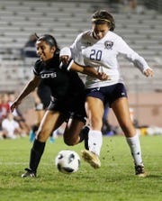 Monica Calderon, of La Quinta overpowers a defender from Cathedral City High School to score in 2018.