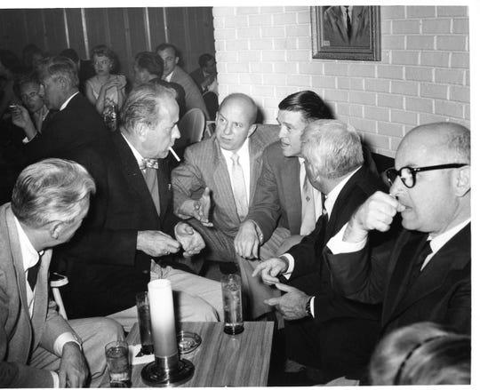 Humphrey Bogart, Jimmy Van Heusen, Earl Johnson, Undersecretary of the Army, and Spencer Tracy at Van Heusen's piano bar at the Desert Inn.