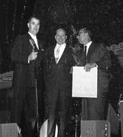 Mayor Frank Bogert, Jimmy Van Heusen and Sammy Cahn at the 1961 Palm Springs Police Show held at Palm Springs High School.