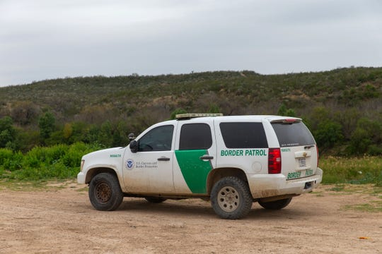 FILE - A United States border patrol car drives near the Rio Grande in Laredo, Texas, on January 14, 2019.