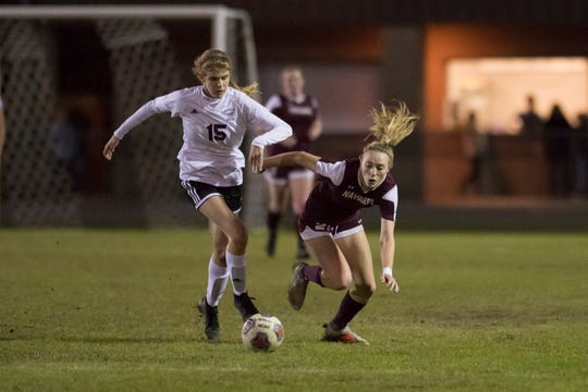 Haley Shelton (15) and Jennifer Seward (22) fight for the ball during the District 1-4A girls soccer tournament final between Niceville and Navarre at Navarre High School on Thursday, January 31, 2019.  Niceville won 7-6 in penalty kicks.
