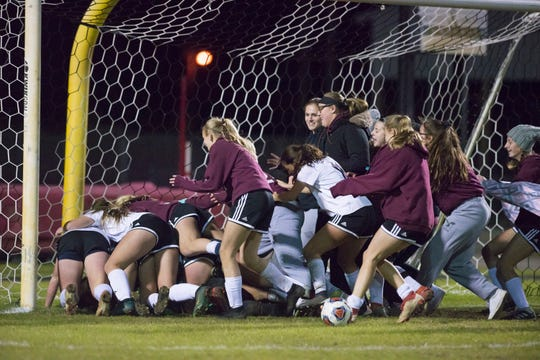 Niceville celebrates after winning the District 1-4A girls soccer tournament final between Niceville and Navarre at Navarre High School on Thursday, January 31, 2019.  Niceville won 7-6 in penalty kicks.
