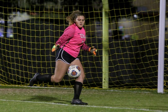 Pensacola Catholic goalkeeper Lacie Day (0) tracks down a loose ball during the District 1-2A championship game against the South Walton Seahawks at Catholic High School on January 31, 2019.