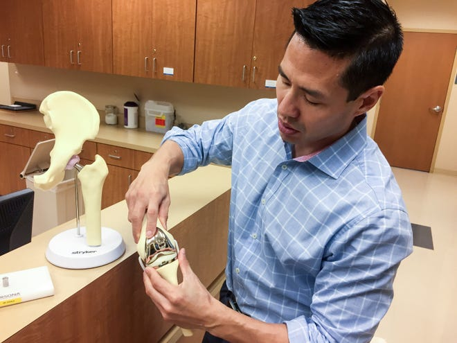 Dr. G. Daxton Steele, an orthopaedic surgeon specializing in total joint surgery with The Andrews Institute, explains the process of performing a knee joint replacement on Friday.