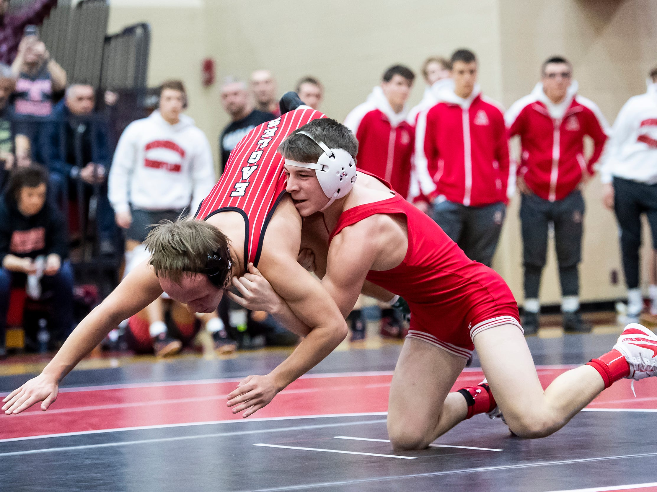 Bermudian Springs' Korey Smith, left, wrestles Hamburg's Bailey Gimbor in a 120-pound bout during a PIAA District III 2A semifinal match at Cumberland Valley High School January 31, 2019. The Eagles fell 43-24.