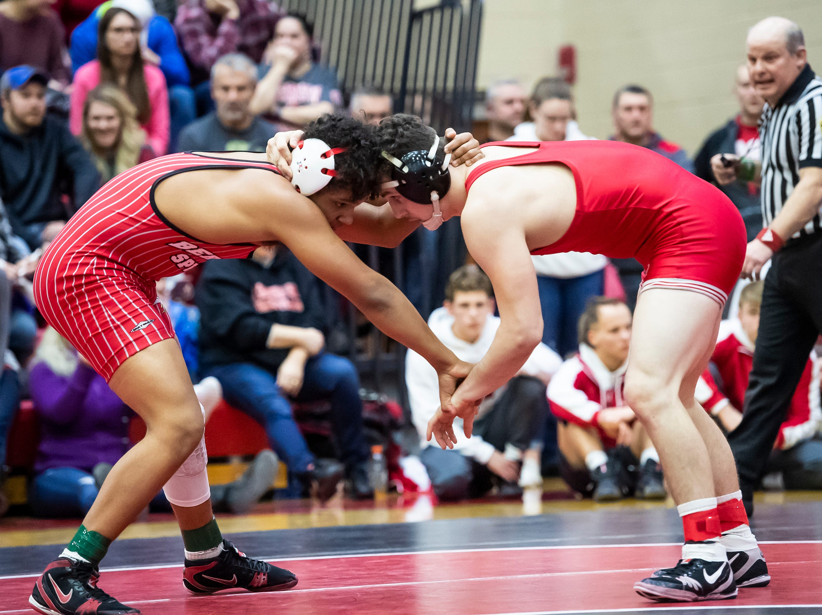 Bermudian Springs' Savauri Shelton, left, wrestles Hamburg's Brendan Hamilton in a 170-pound bout during a PIAA District III 2A semifinal match at Cumberland Valley High School January 31, 2019. The Eagles fell 43-24.