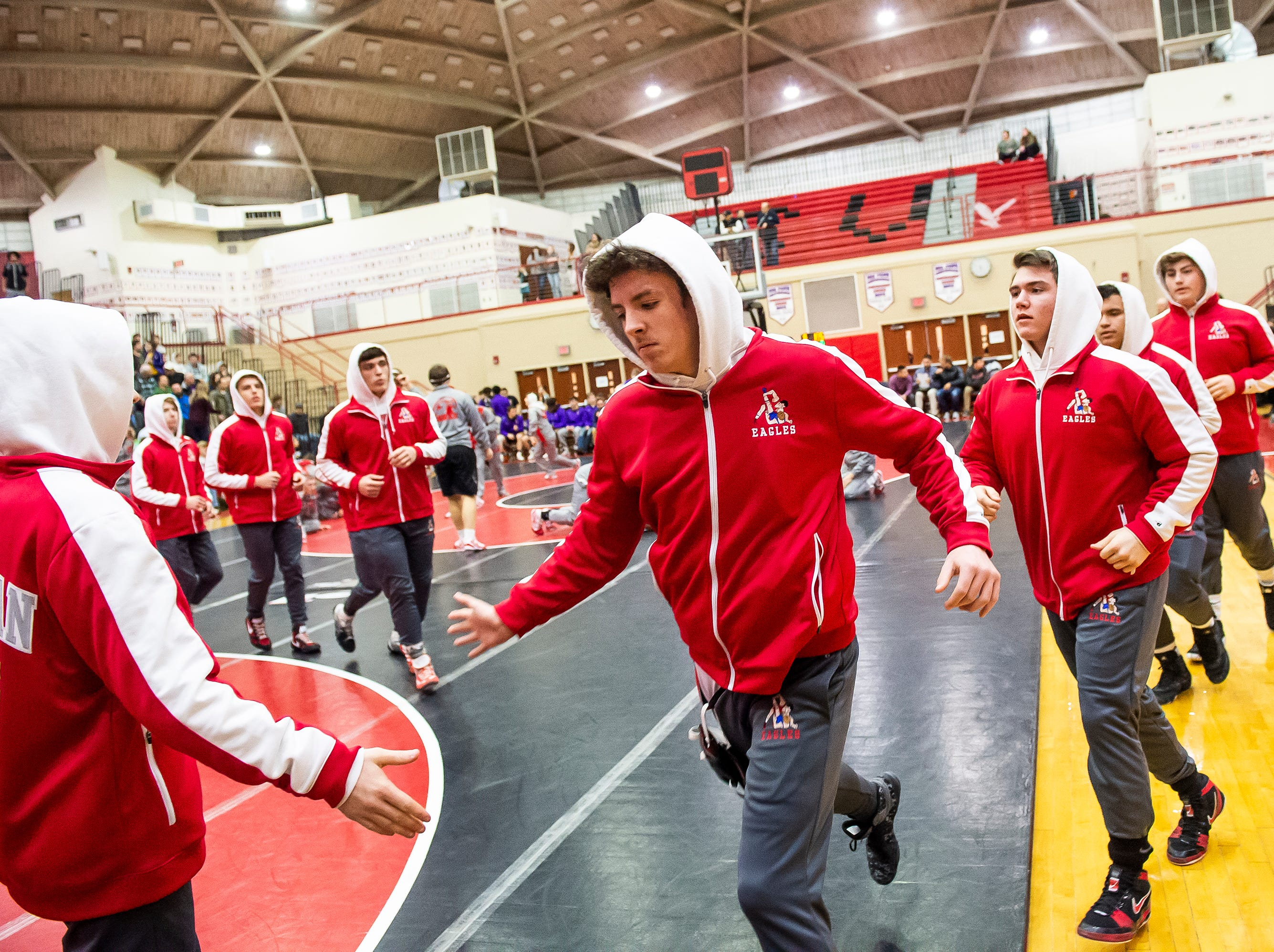 The Bermudian Springs wrestling team warms up prior to a PIAA District III 2A quarterfinal match at Cumberland Valley High School January 31, 2019.