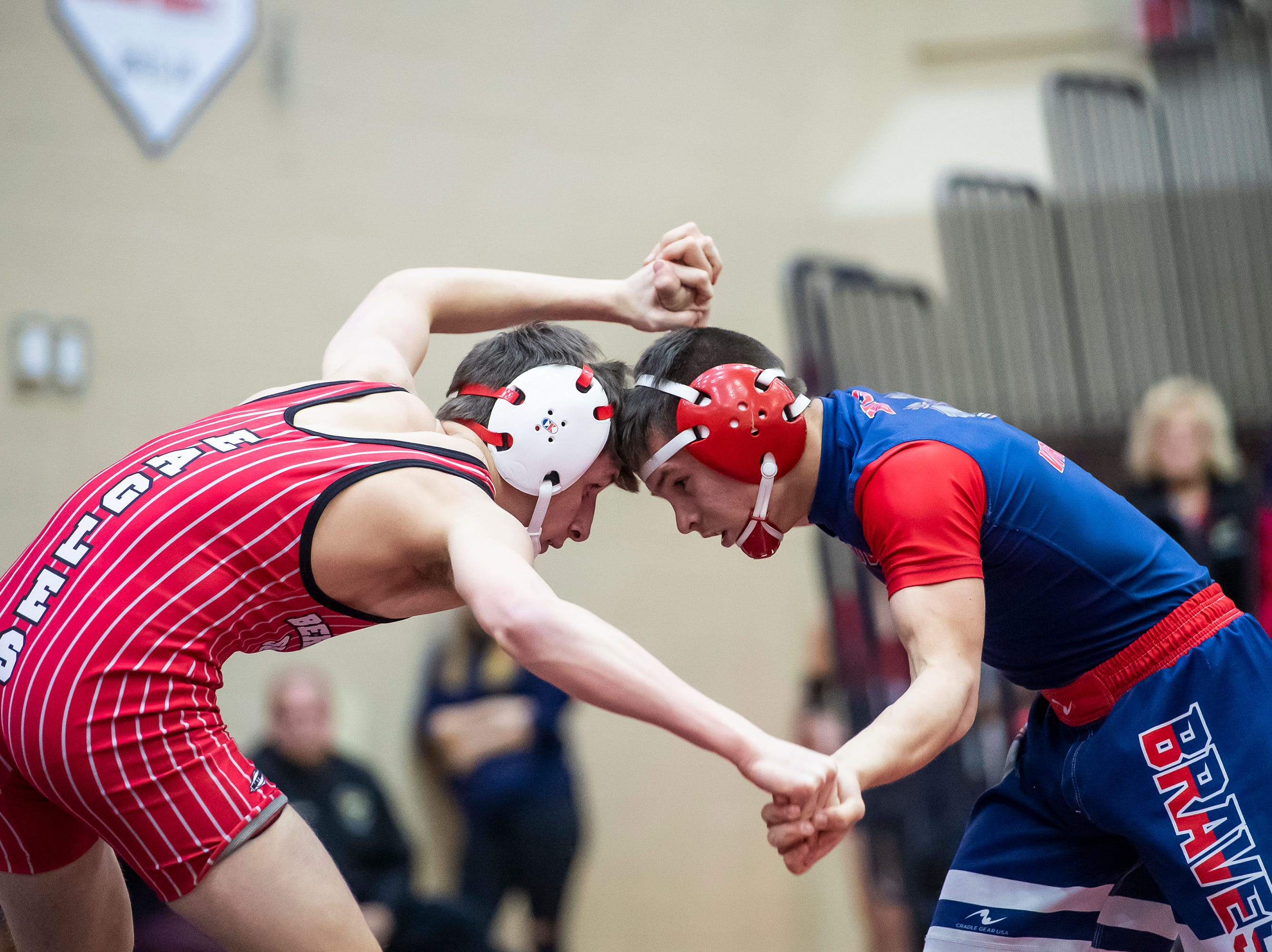 Bermudian Springs' Caleb Mantz, left, wrestles Octorara's Seth Hoopes in the 126-pound bout during a PIAA District III 2A quarterfinal match at Cumberland Valley High School January 31, 2019. The Eagles beat Octorara 42-23.