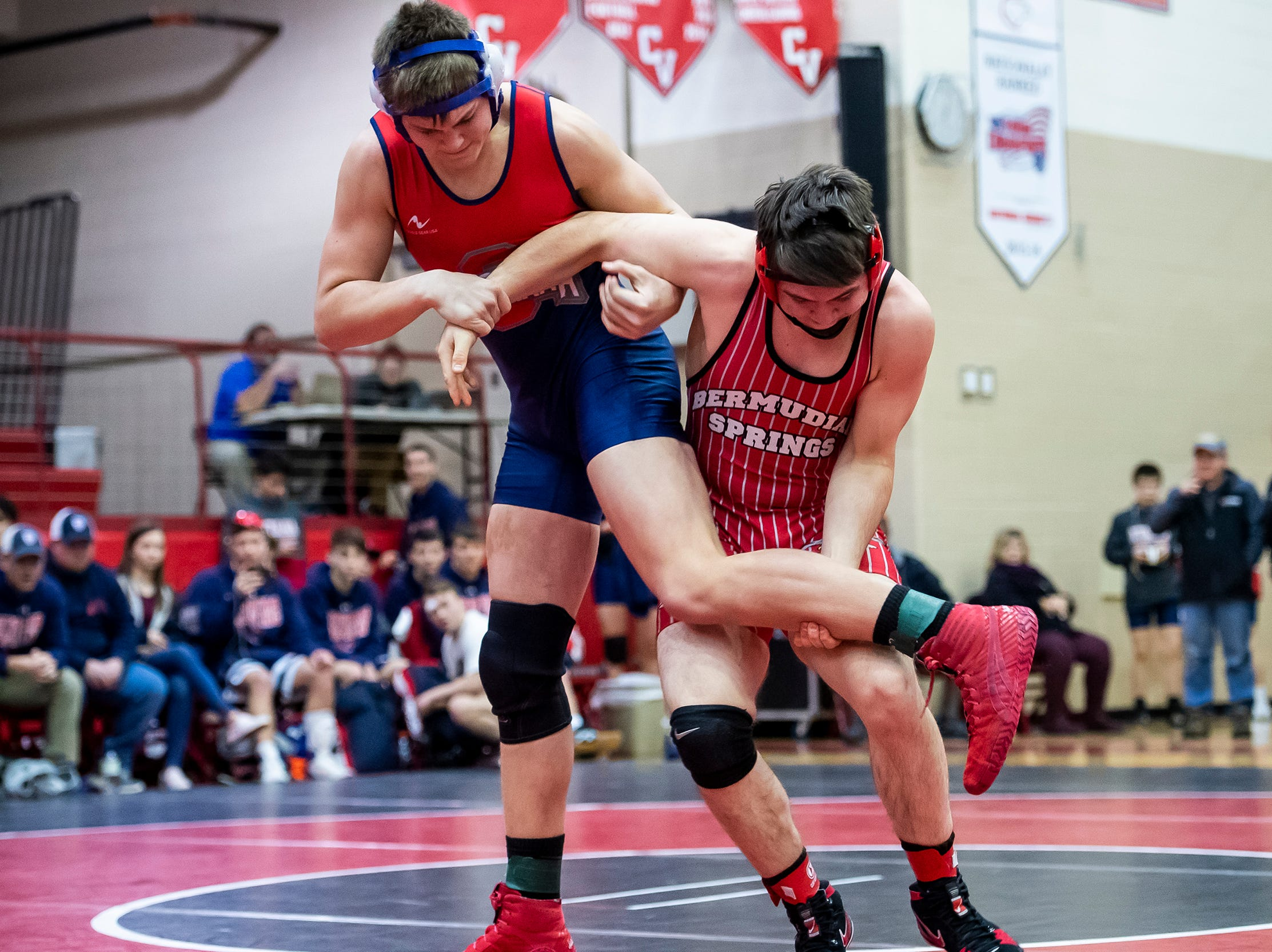 Bermudian Springs' Josh Keller, right, wrestles Octorara's Jacob Eckman in the 220-pound bout during a PIAA District III 2A quarterfinal match at Cumberland Valley High School January 31, 2019. The Eagles beat Octorara 42-23.