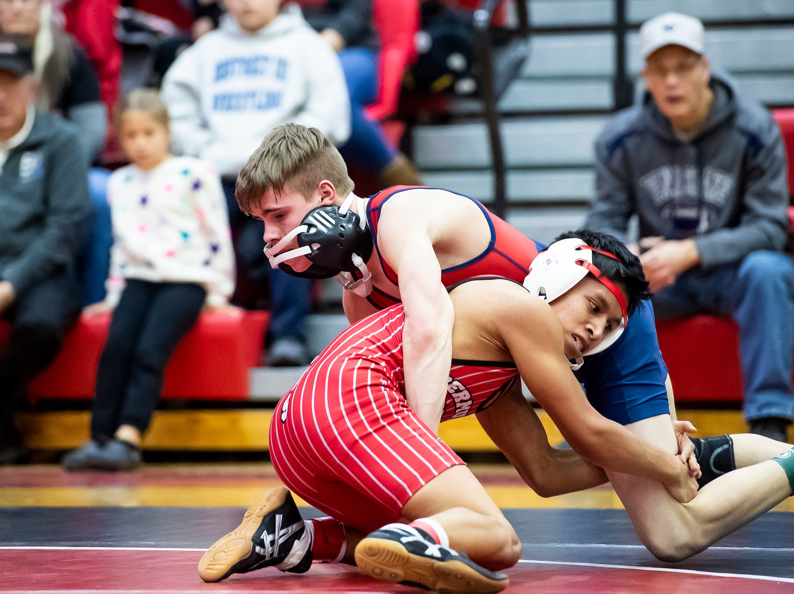 Bermudian Springs' Coby Johnston, bottom, wrestles Octorara's Connor Jeffries in the 106-pound bout during a PIAA District III 2A quarterfinal match at Cumberland Valley High School January 31, 2019. The Eagles beat Octorara 42-23.