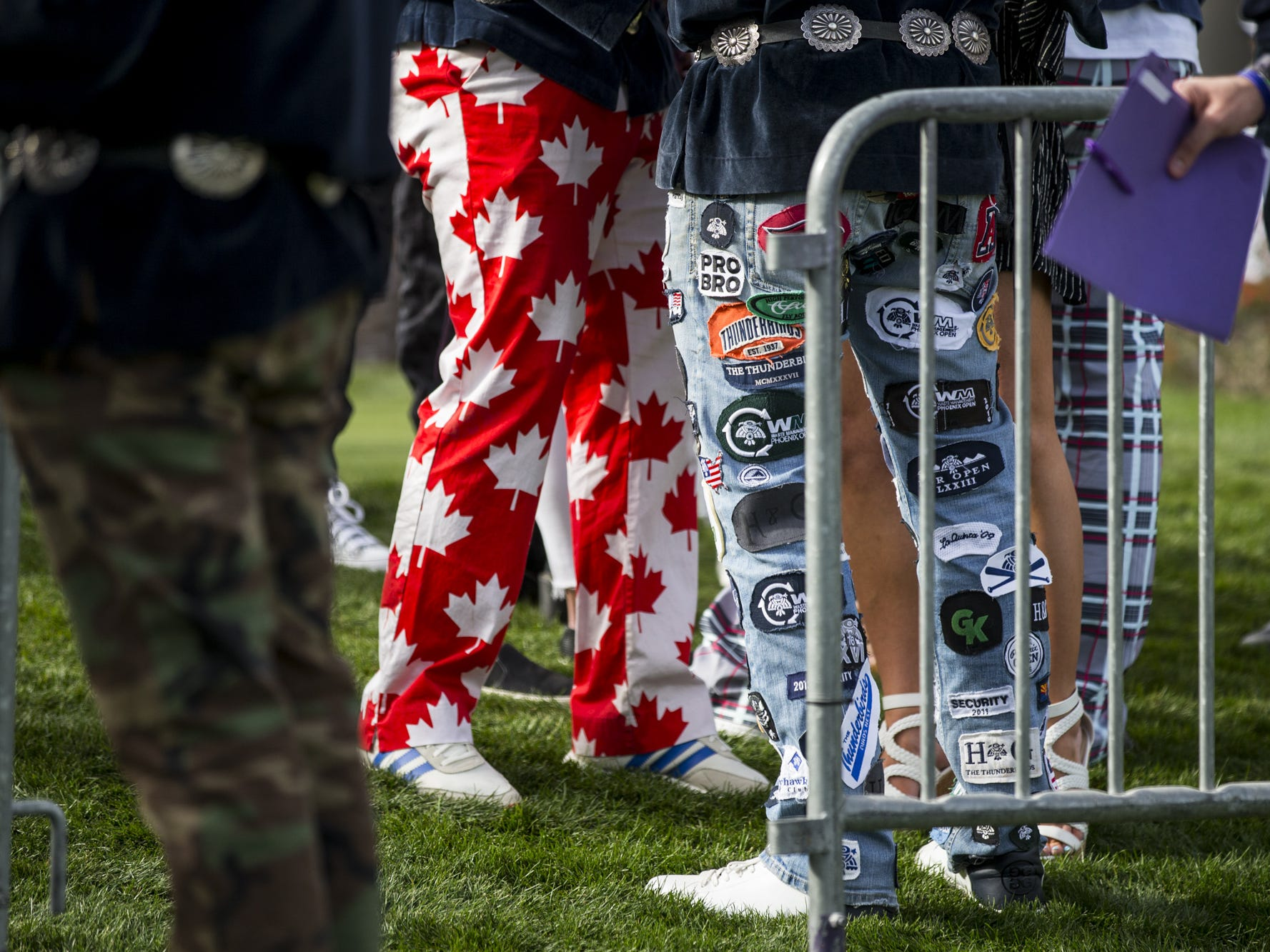 Fans wearing decorative pants stand near the tee at the 16th hole during the Annexus Pro-Am on Wednesday, Jan. 30, 2019, at TPC Scottsdale in Scottsdale, Ariz.