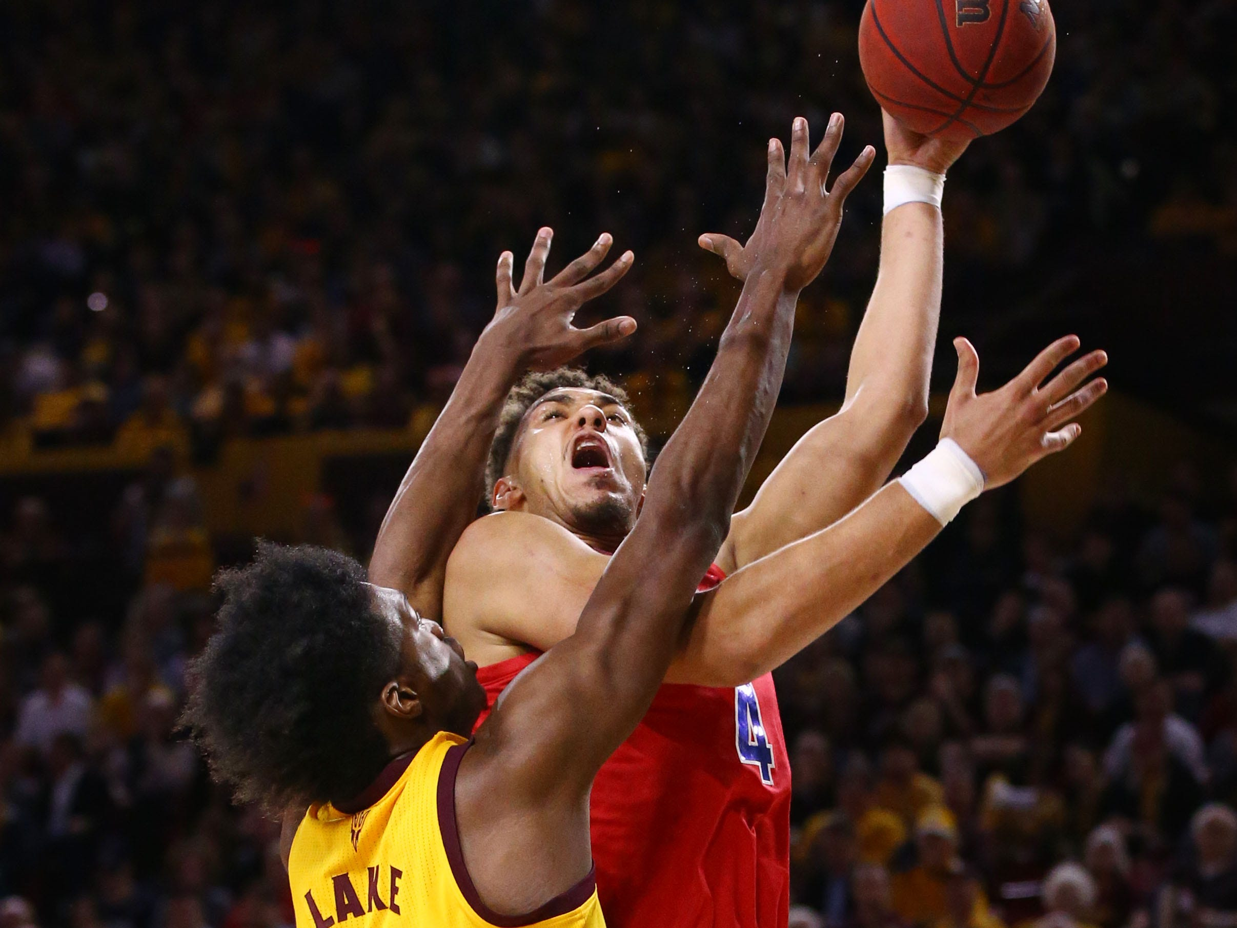 Arizona State forward De'Quon Lake guards Arizona center Chase Jeter in the first half on Jan. 31 at Wells Fargo Arena in Tempe.