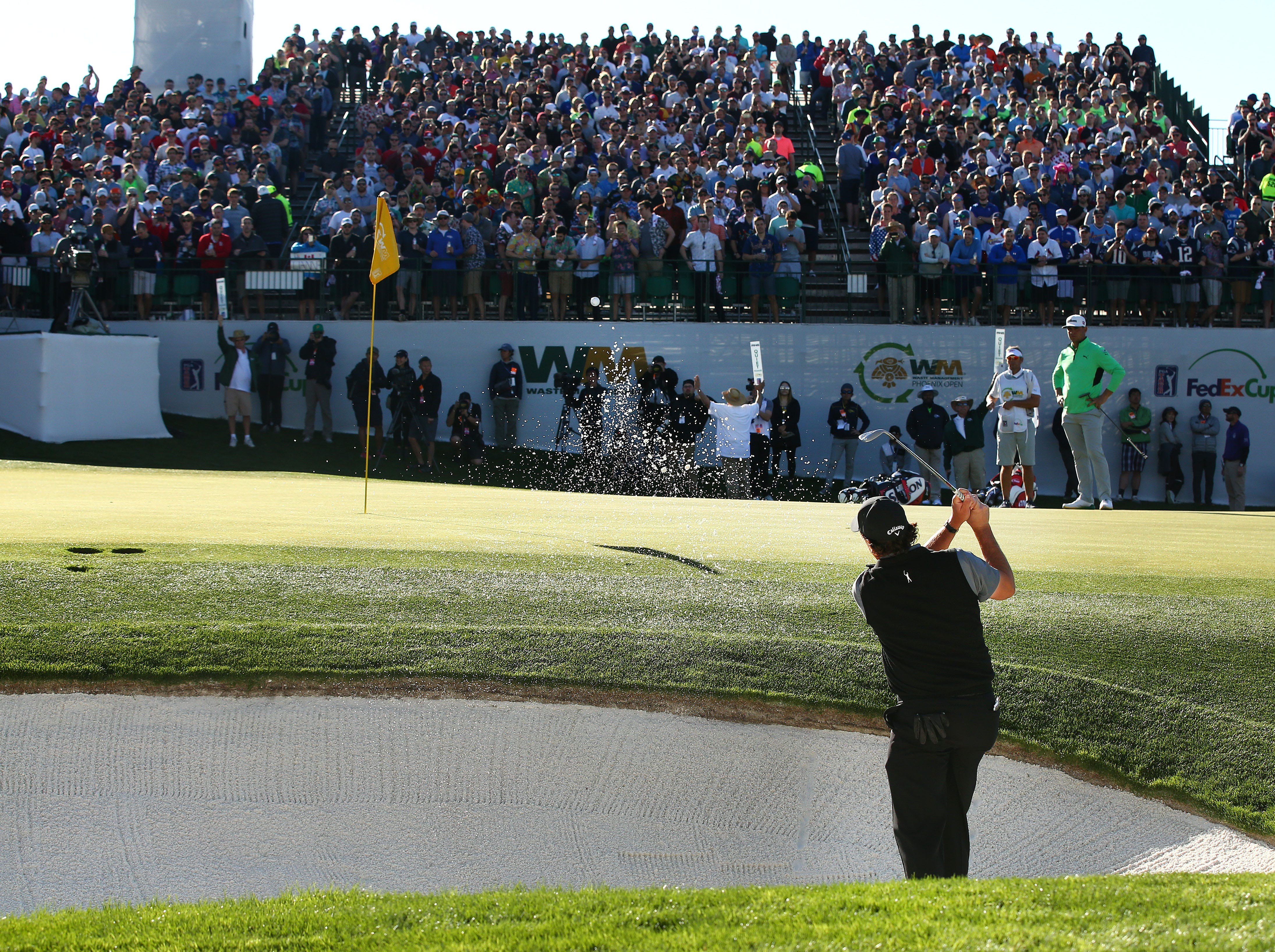 Phil Mickelson plays his third shot from the bunker on the 16th hole during second round action on Feb. 1 during the Waste Management Phoenix Open at the TPC Scottsdale Stadium Course.