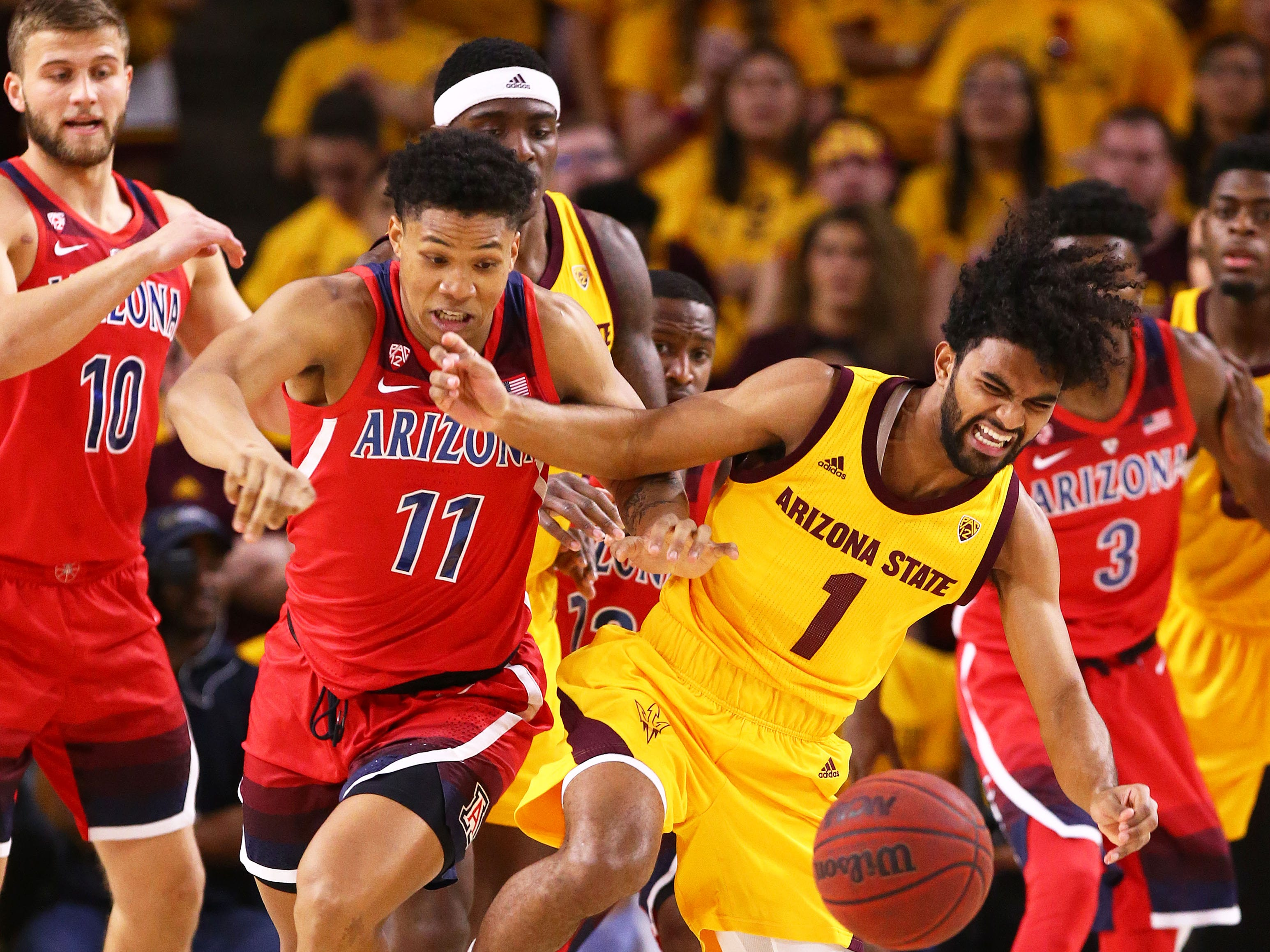 Arizona forward Ira Lee (11) against Arizona State guard Remy Martin (1) battle for the loose ball in the first half on Jan. 31 at Wells Fargo Arena in Tempe.