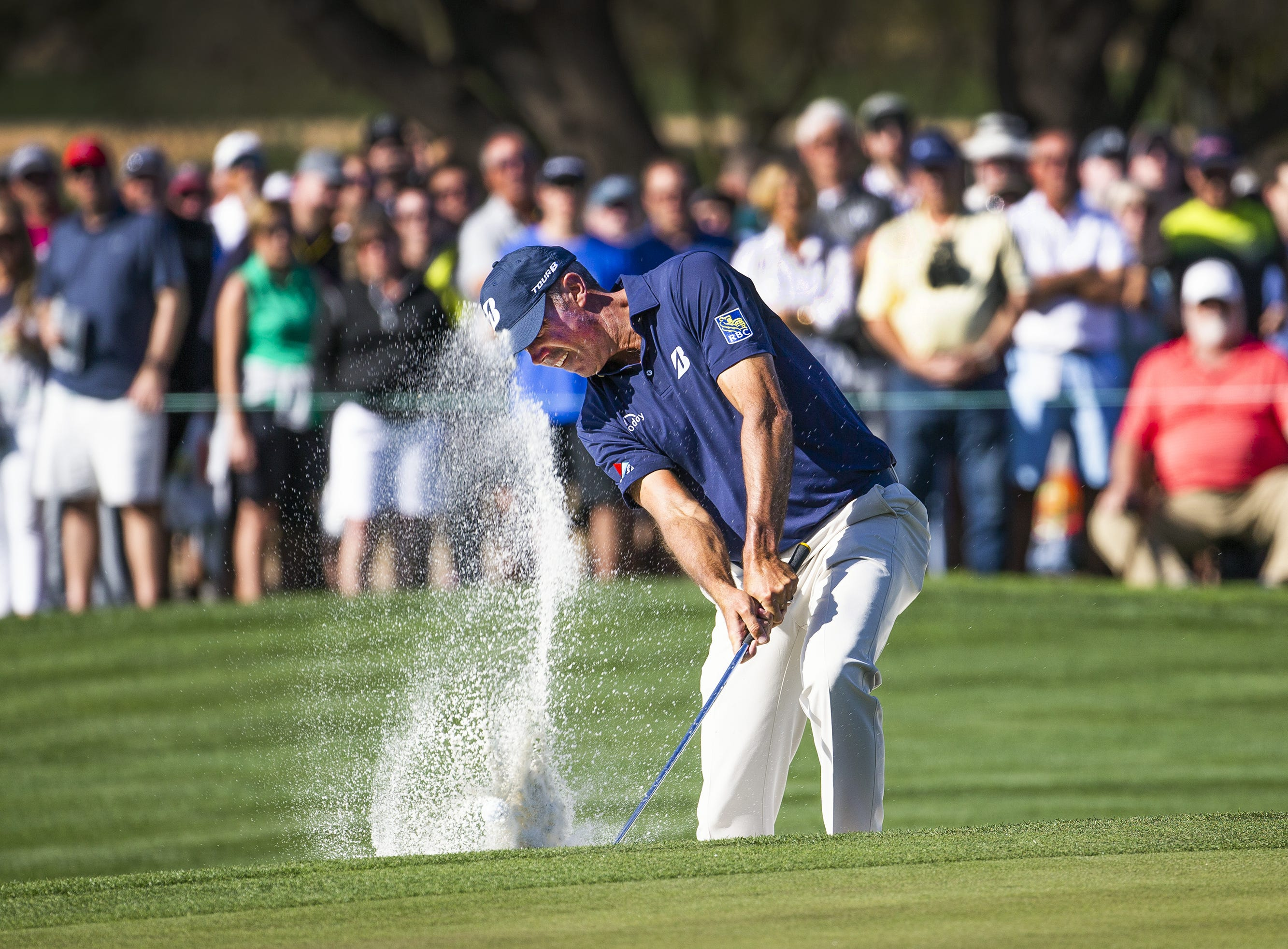 Matt Kuchar hits from a bunker on the 9th hole during the second round of the Waste Management Phoenix Open at the TPC Scottsdale, Friday, February 1, 2019.