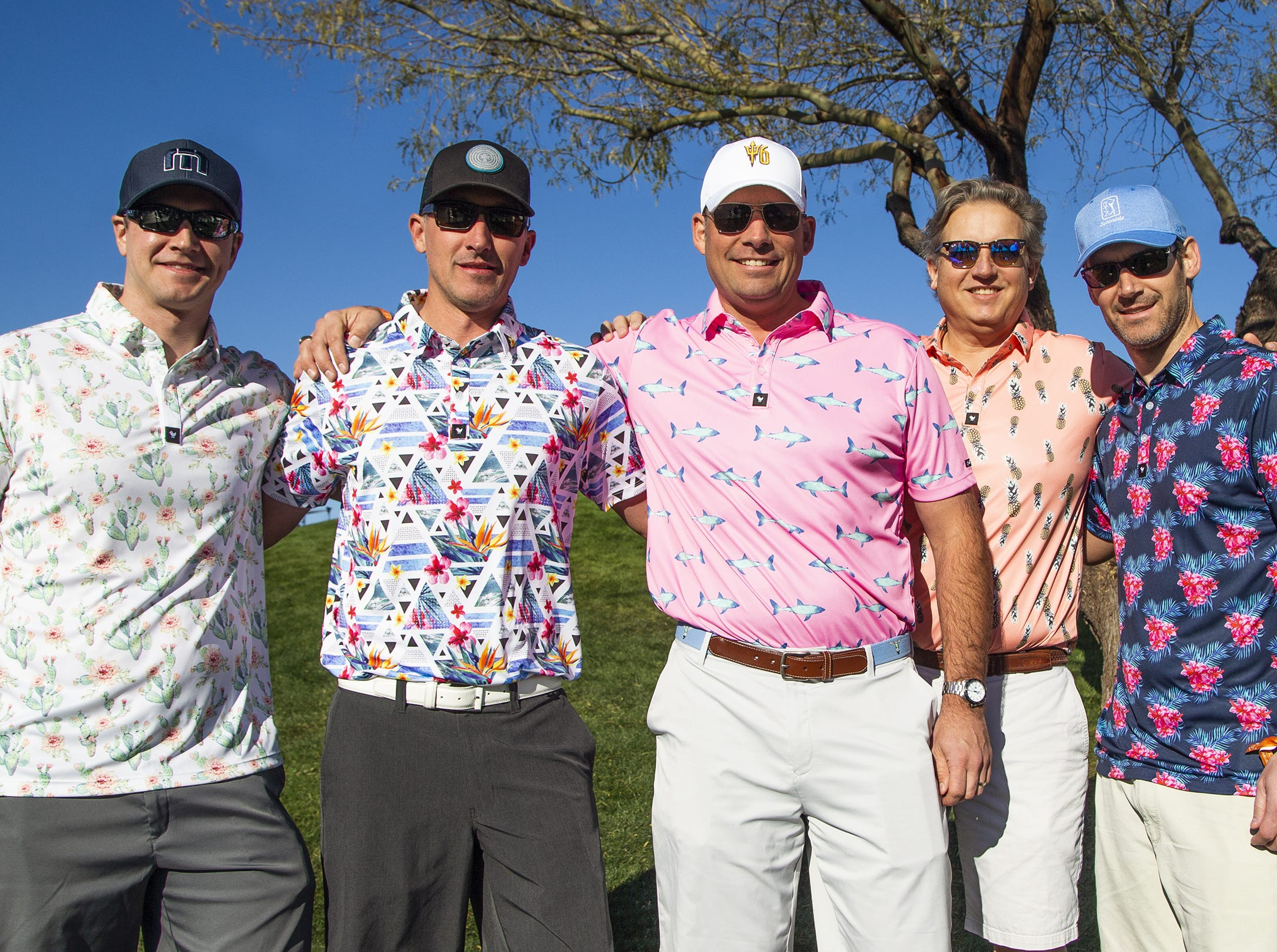 A group of friends from Pittsburgh wear colorful attire during the second round of the Waste Management Phoenix Open at the TPC Scottsdale, Friday, February 1, 2019. From left to right are; Paul Kress, 35, Paul Pilkenton, 44, Rick Johnson, 40, Marcus Sass, 50, and Blue Jenkins, 38.