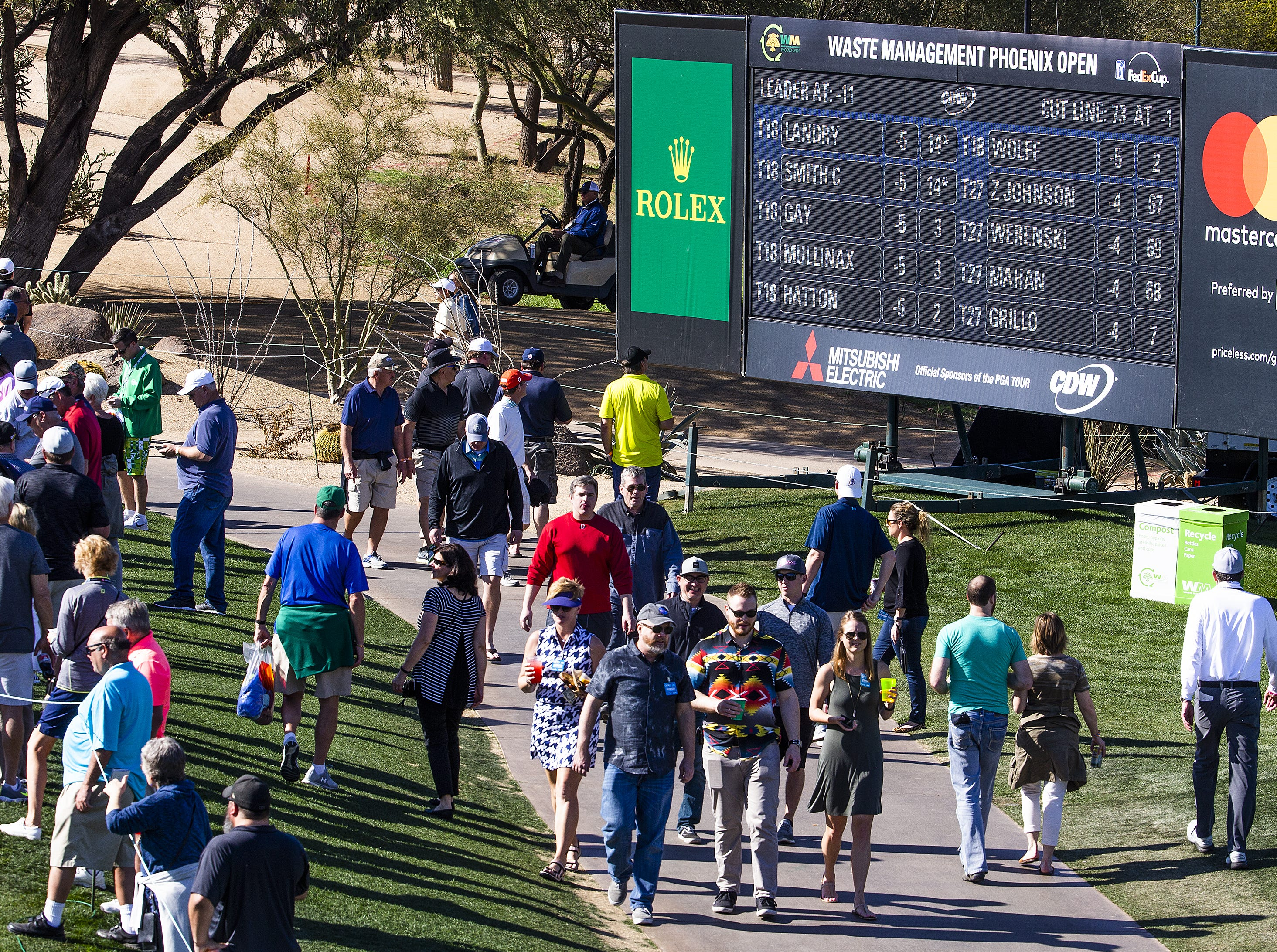 The crowd makes its way past the 9th hole during the second round of the Waste Management Phoenix Open at the TPC Scottsdale, Friday, February 1, 2019.