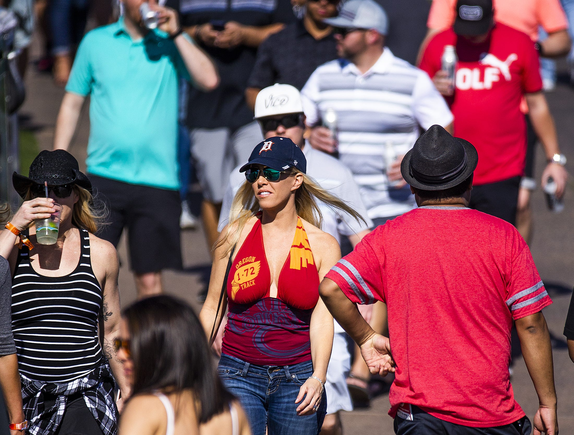 The crowd makes its way past the driving range during the second round of the Waste Management Phoenix Open at the TPC Scottsdale, Friday, February 1, 2019.