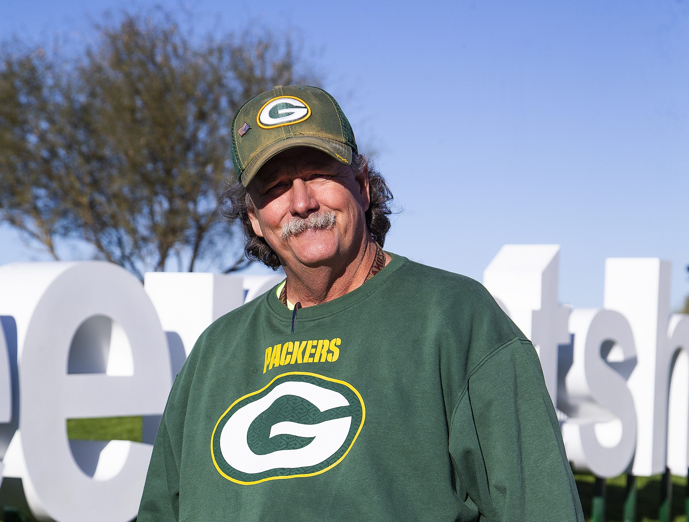 Mark Haefs, 63, Tempe, wears his Green Bay Packers swag during the second round of the Waste Management Phoenix Open at the TPC Scottsdale, Friday, February 1, 2019.