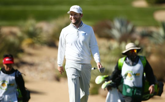 Branden Grace smiles as the fans cheer on the 16th hole during second round action on Feb. 1 during the Waste Management Phoenix Open at the TPC Scottsdale Stadium Course.