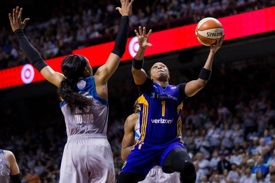 Los Angeles Sparks guard Odyssey Sims (1) shoots in the fourth quarter against the Minnesota Lynx forward Maya Moore (23) in Game 5 of the WNBA Finals at Williams Arena.