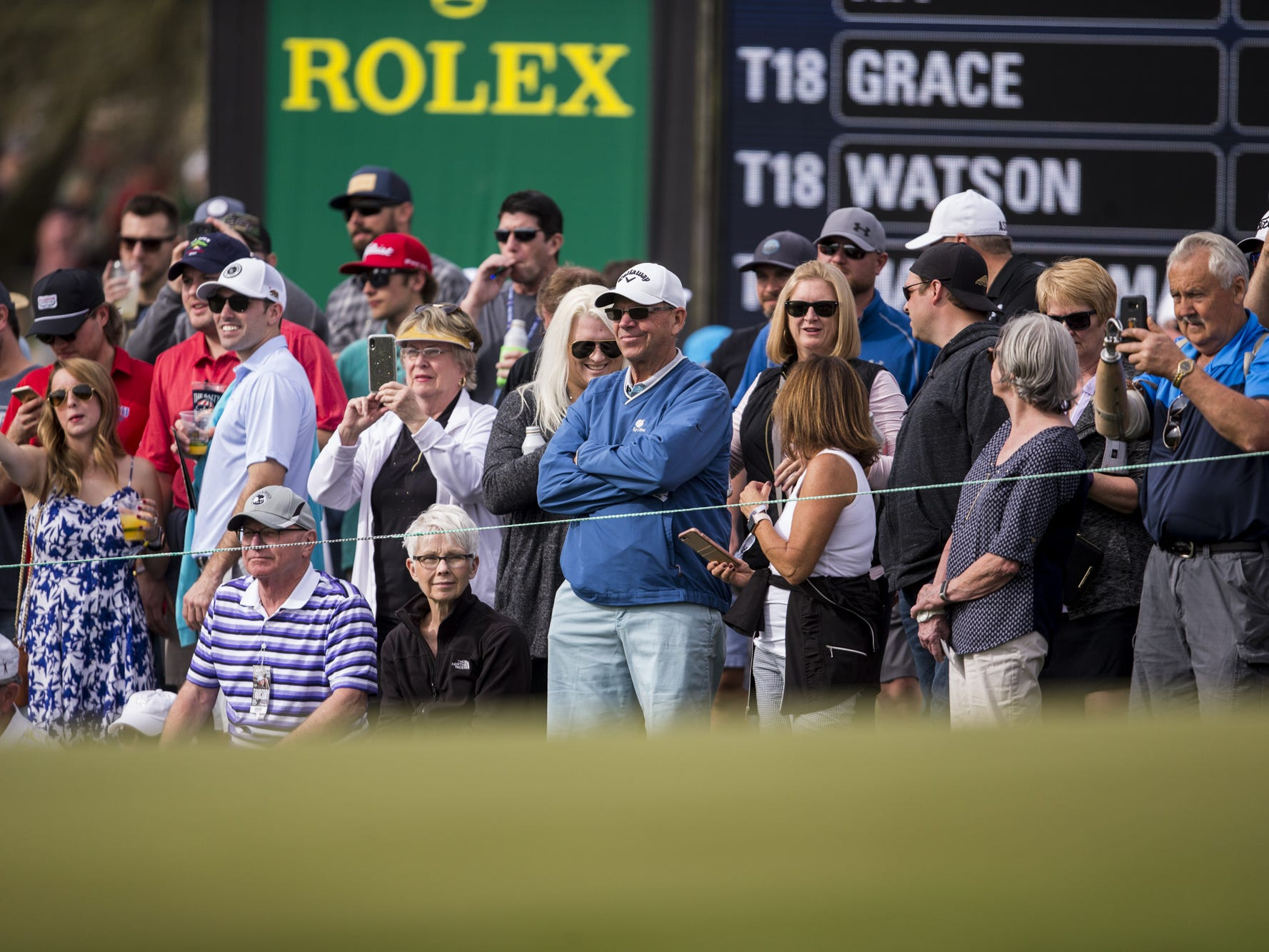 Fans watch at the 9th hole during the Waste Management Phoenix Open on Thursday, Jan. 31, 2019, at TPC Scottsdale in Scottsdale, Ariz.