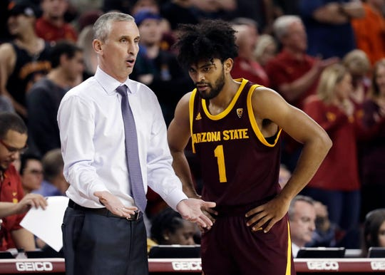 Arizona State head coach Bobby Hurley, left, talks to guard Remy Martin (1) during the second half of an NCAA college basketball game against Southern California Saturday, Jan. 26, 2019, in Los Angeles. (AP Photo/Marcio Jose Sanchez)