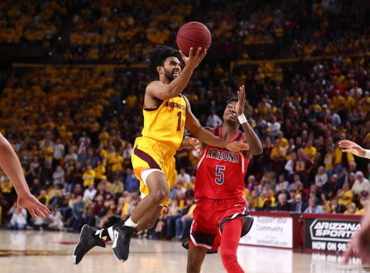 Jan 31, 2019; Tempe, AZ, USA; Arizona State Sun Devils guard Remy Martin (1) drives to the basket against Arizona Wildcats guard Brandon Randolph (5) in overtime at Wells Fargo Arena Jan. 31. Mark J. Rebilas-USA TODAY Sports