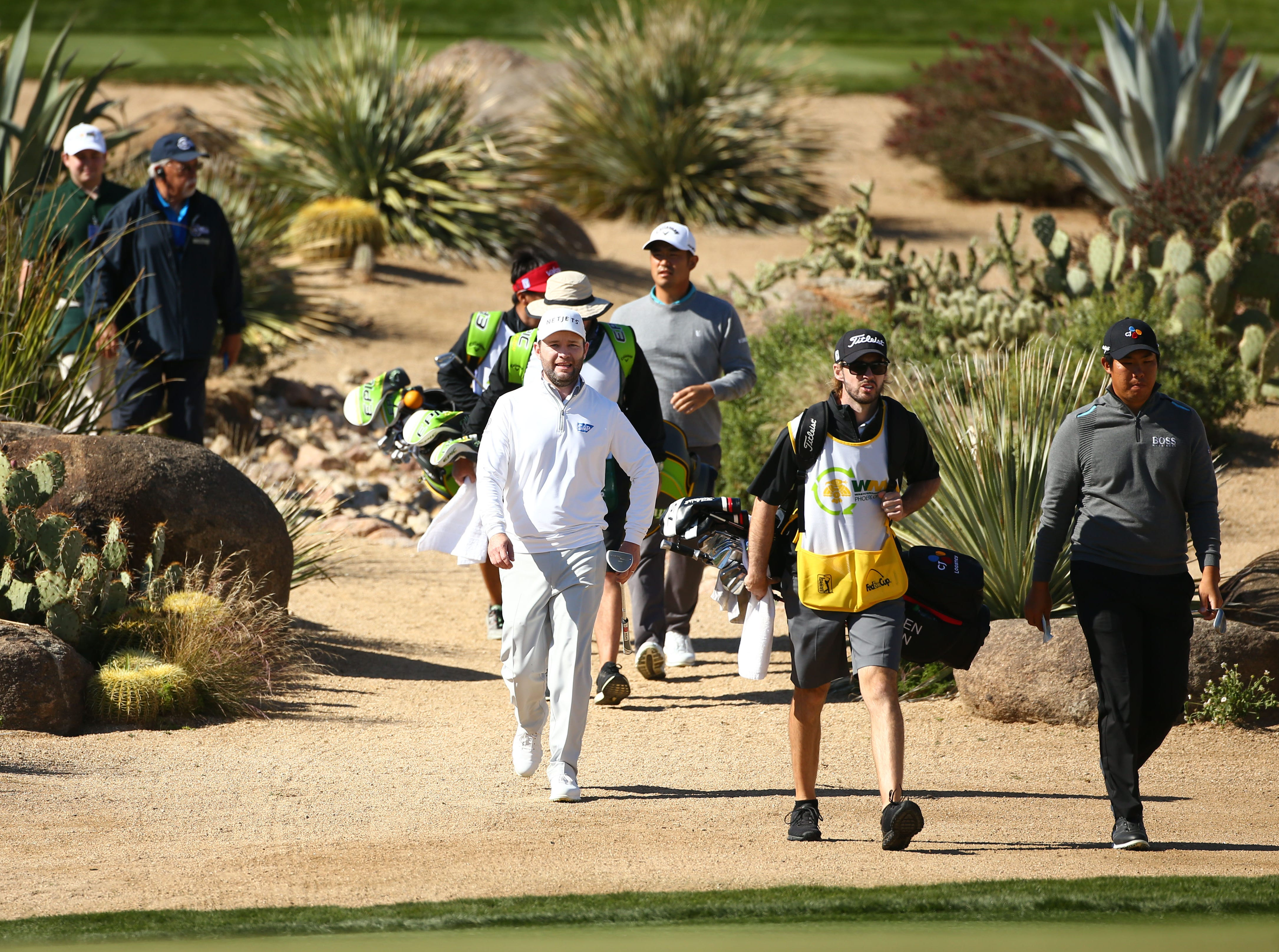 Branden Grace walks to the 16th green during second round action on Feb. 1 during the Waste Management Phoenix Open at the TPC Scottsdale Stadium Course.
