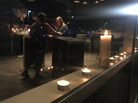 Drivers hold candles in honor of Kristina Howato on Jan. 31, 2019.