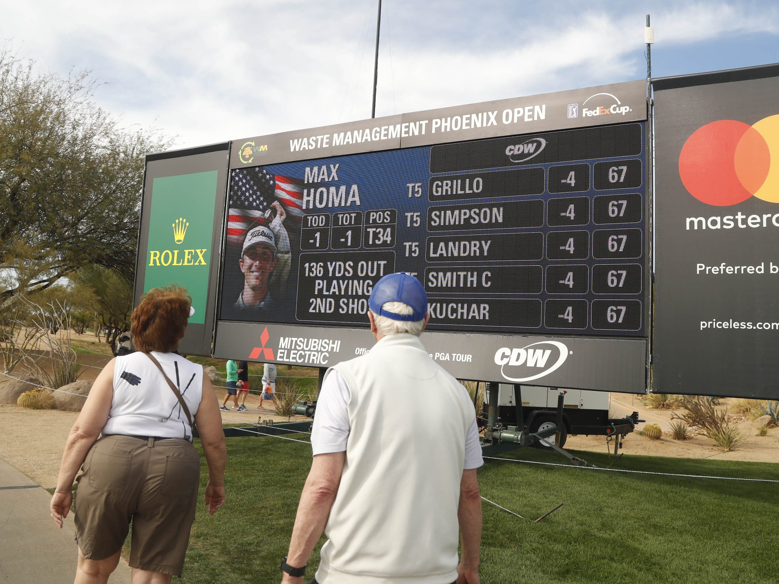 People make their way around the Waste Management Phoenix Open at TPC Scottsdale on the first round of the tournament in Scottsdale, Ariz. on January 31, 2019.