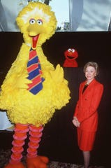 "Joan Ganz Cooney, founder of Children's Television Workshop, stands with ""Sesame Street"" characters Big Bird and Elmo during the launching of the 30th season of ""Sesame Street"" at New York's Tavern on the Green Tuesday, Oct. 6, 1998."
