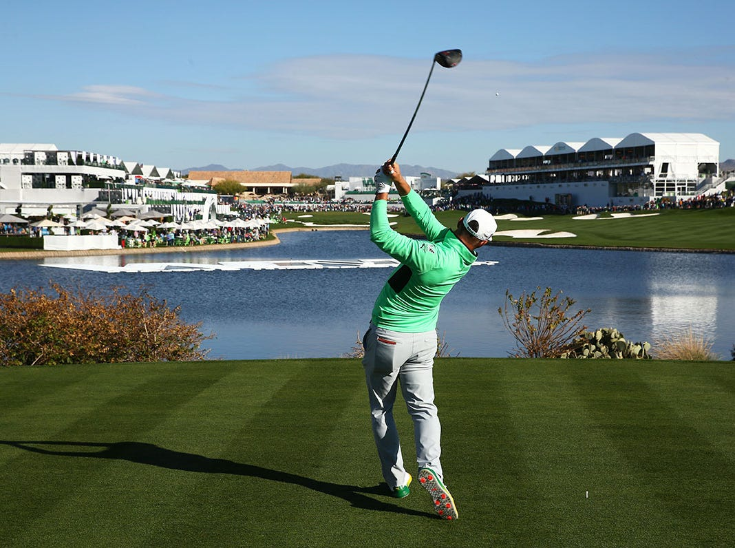 Gary Woodland hits his drive on the 18th hole during second round action on Feb. 1 during the Waste Management Phoenix Open at the TPC Scottsdale Stadium Course.