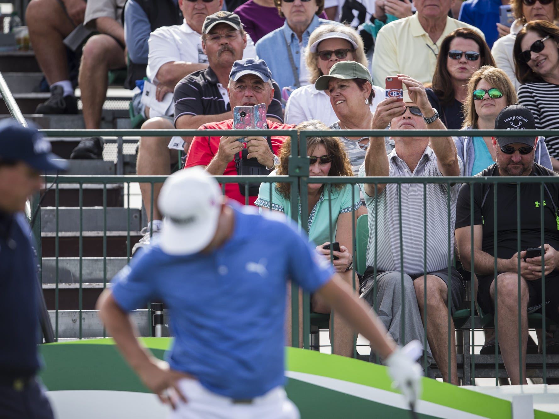 Fans watch as Phil Mickelson (left) and Gary Woodland prepare to tee off at the 1st hole during the Waste Management Phoenix Open on Thursday, Jan. 31, 2019, at TPC Scottsdale in Scottsdale, Ariz.