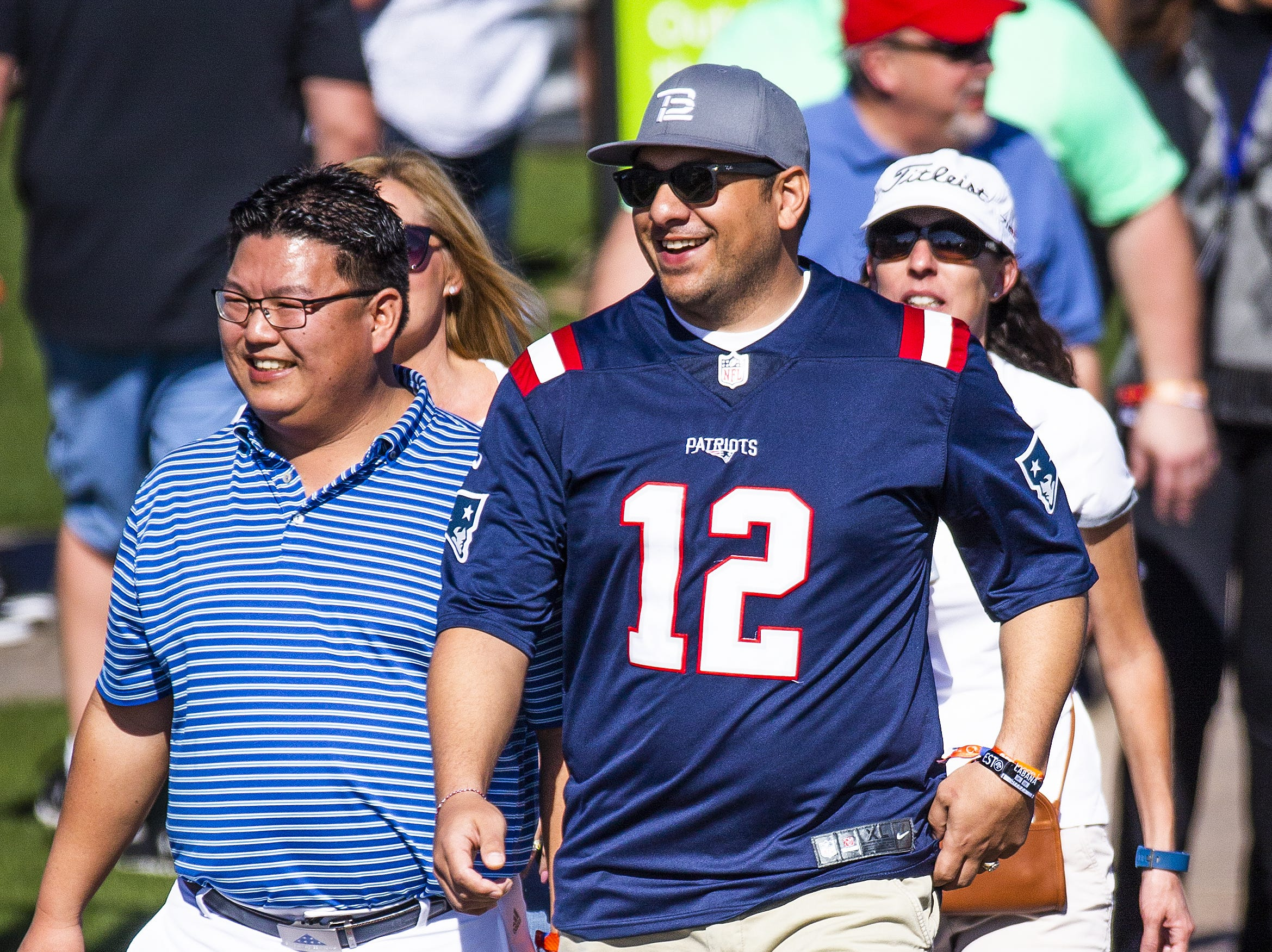 Damion Kindle, 35, Gilbert, proudly wears his New England Patriots Tom Brady jersey through the crowd during the second round of the Waste Management Phoenix Open at the TPC Scottsdale, Friday, February 1, 2019.