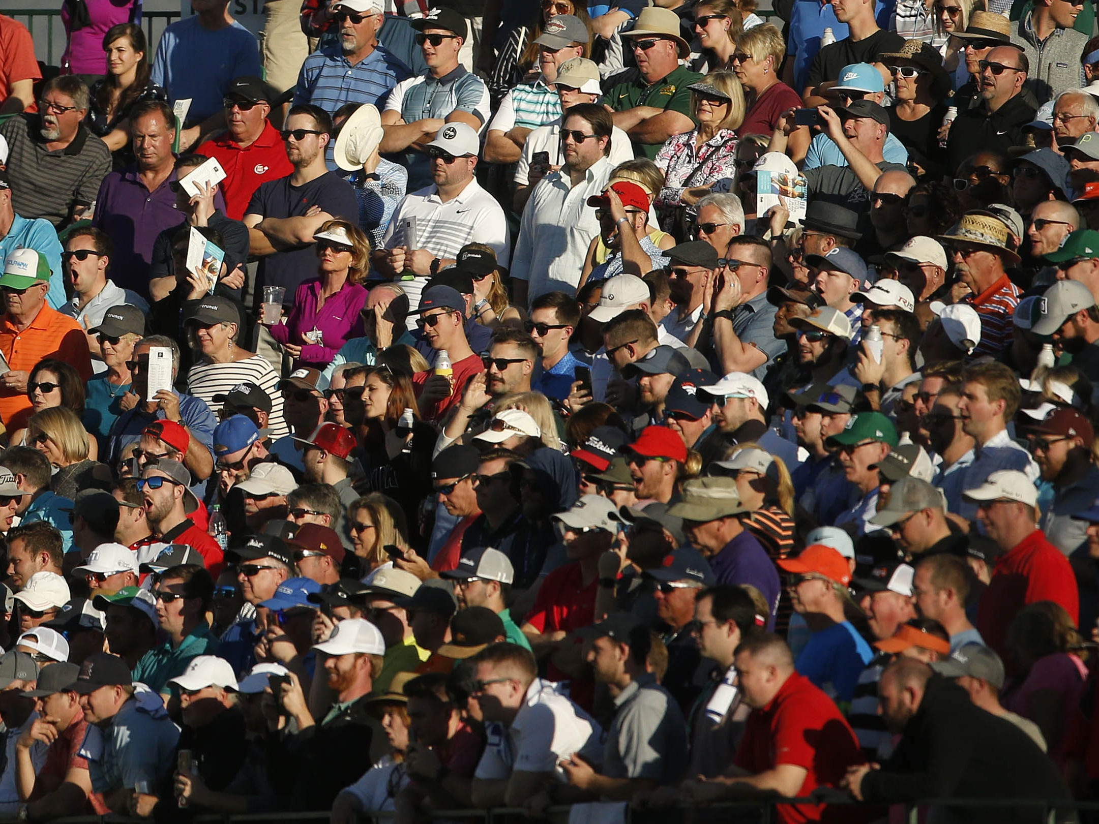 Fans watch Bubba Watson putt on the 16th hole during first round of the Waste Management Phoenix Open at TPC Scottsdale in Scottsdale, Ariz. on January 31, 2019.