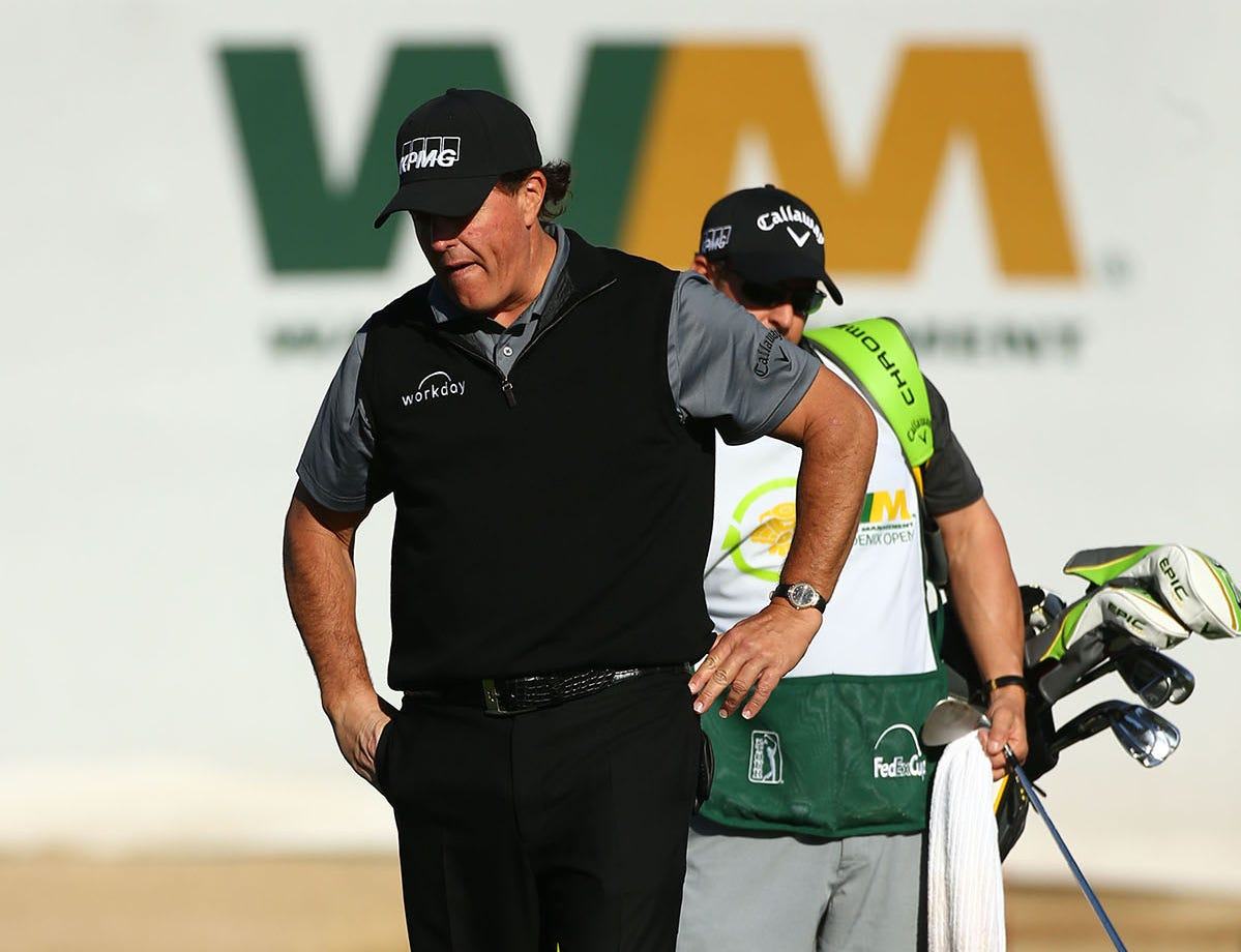 Phil Mickelson reacts after chipping his ball over the green on the 17th hole during second round action on Feb. 1 during the Waste Management Phoenix Open at the TPC Scottsdale Stadium Course.