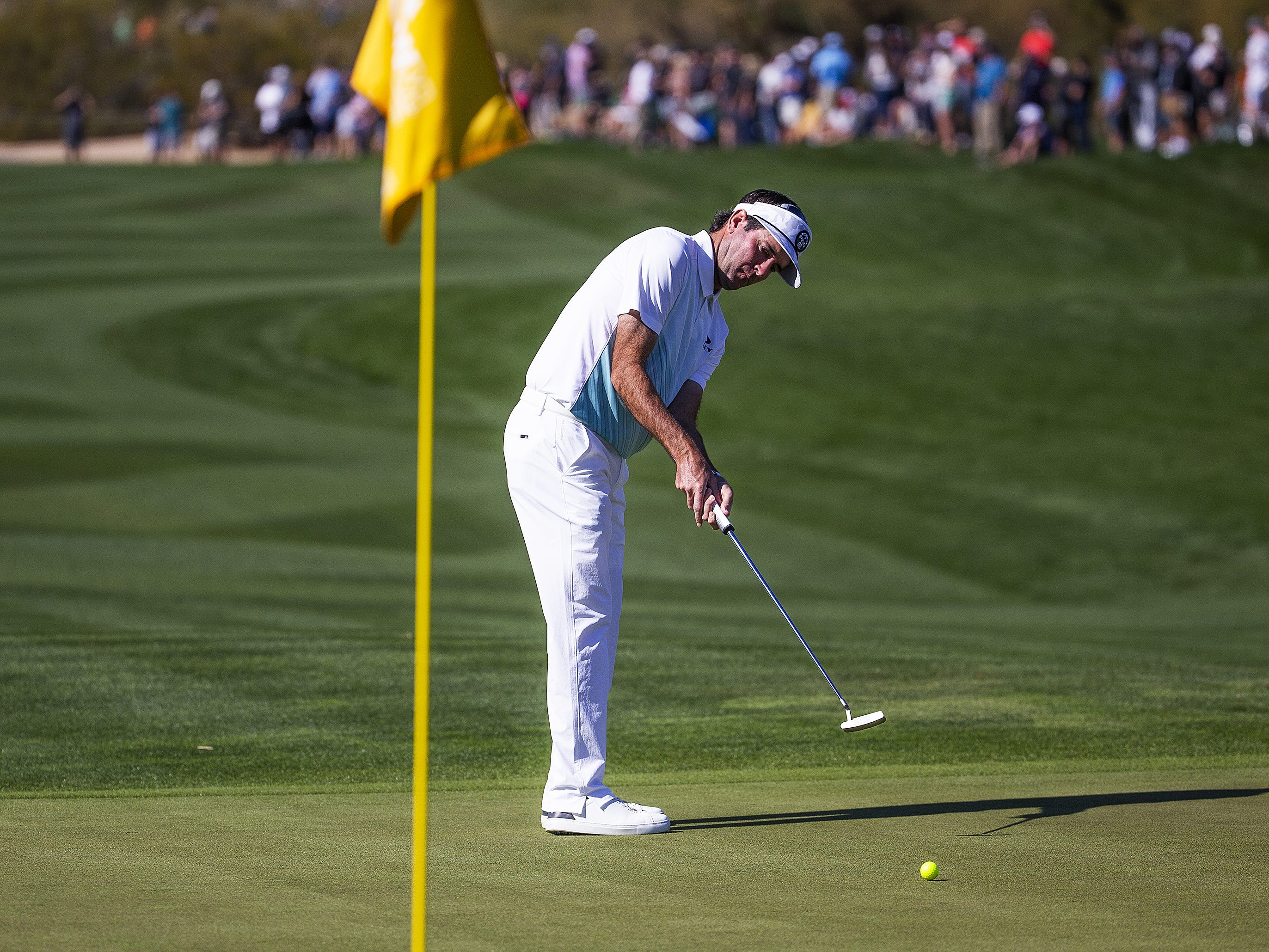 Bubba Watson putts on the 9th hole during the second round of the Waste Management Phoenix Open at the TPC Scottsdale, Friday, February 1, 2019.  When Watson finished his round he was in second place at 9 under par.