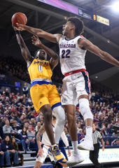 Dec 31, 2018; Spokane, WA, USA; Cal State Bakersfield Roadrunners guard Jarkel Joiner (0) shoots the basketball against Gonzaga Bulldogs forward Jeremy Jones (22) in the second half at McCarthey Athletic Center. The Bulldogs won 89-54. Mandatory Credit: James Snook-USA TODAY Sports