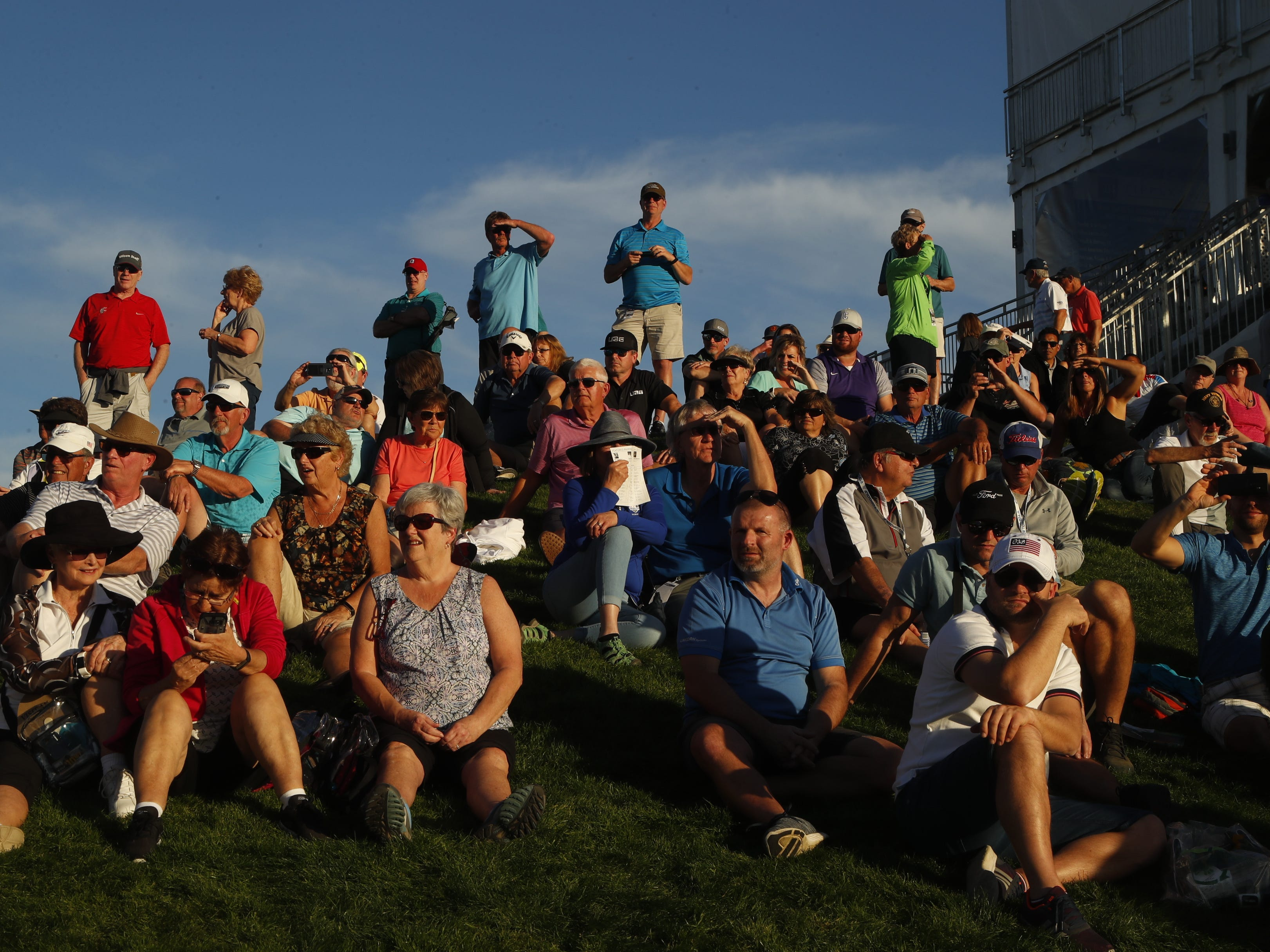 Fans watch players come up on the 18th green during first round of the Waste Management Phoenix Open at TPC Scottsdale in Scottsdale, Ariz. on January 31, 2019.
