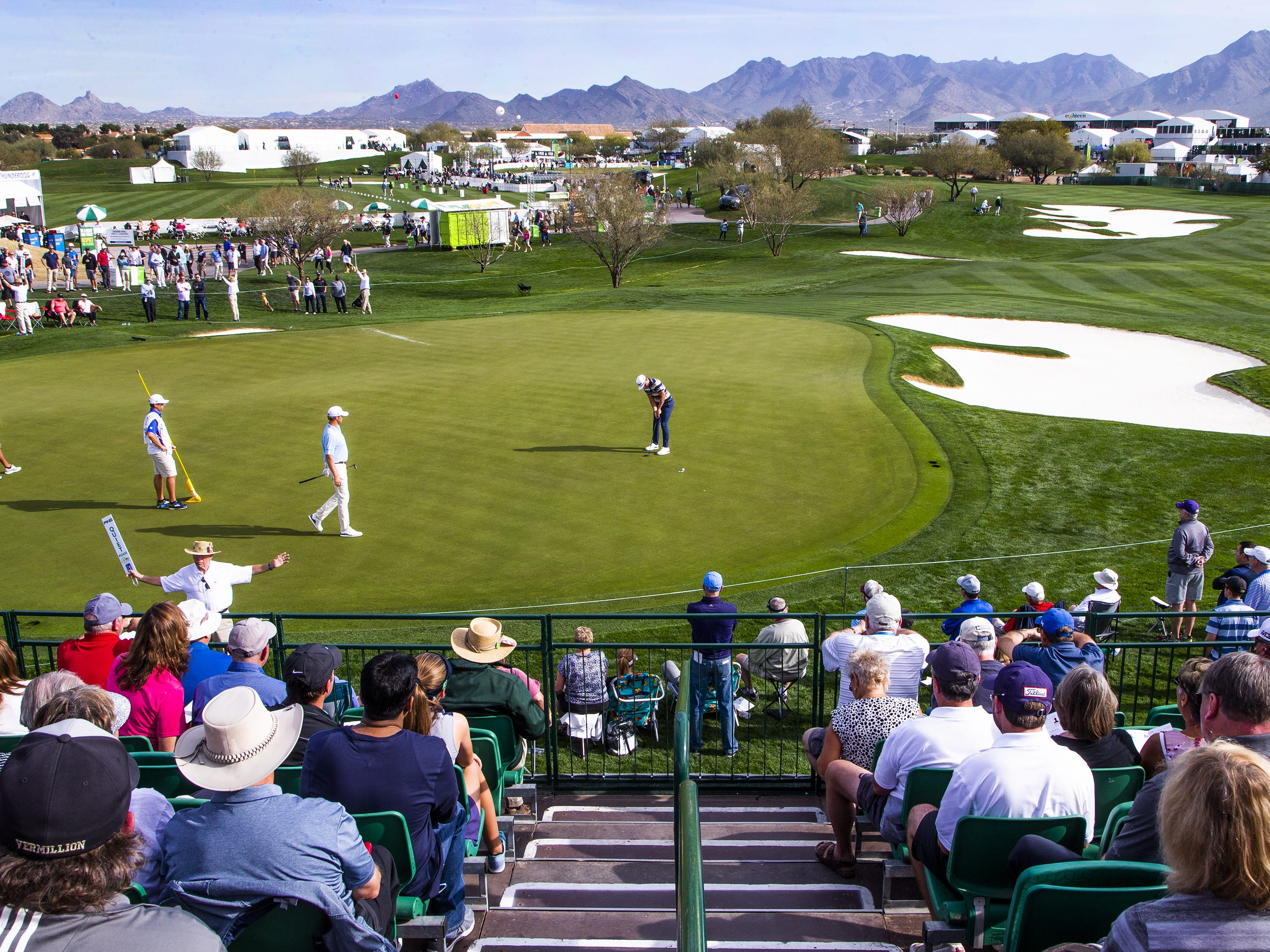 Fans watch action on the 10th hole during the first round of the Waste Management Phoenix Open at the TPC Scottsdale,  January 31, 2019.